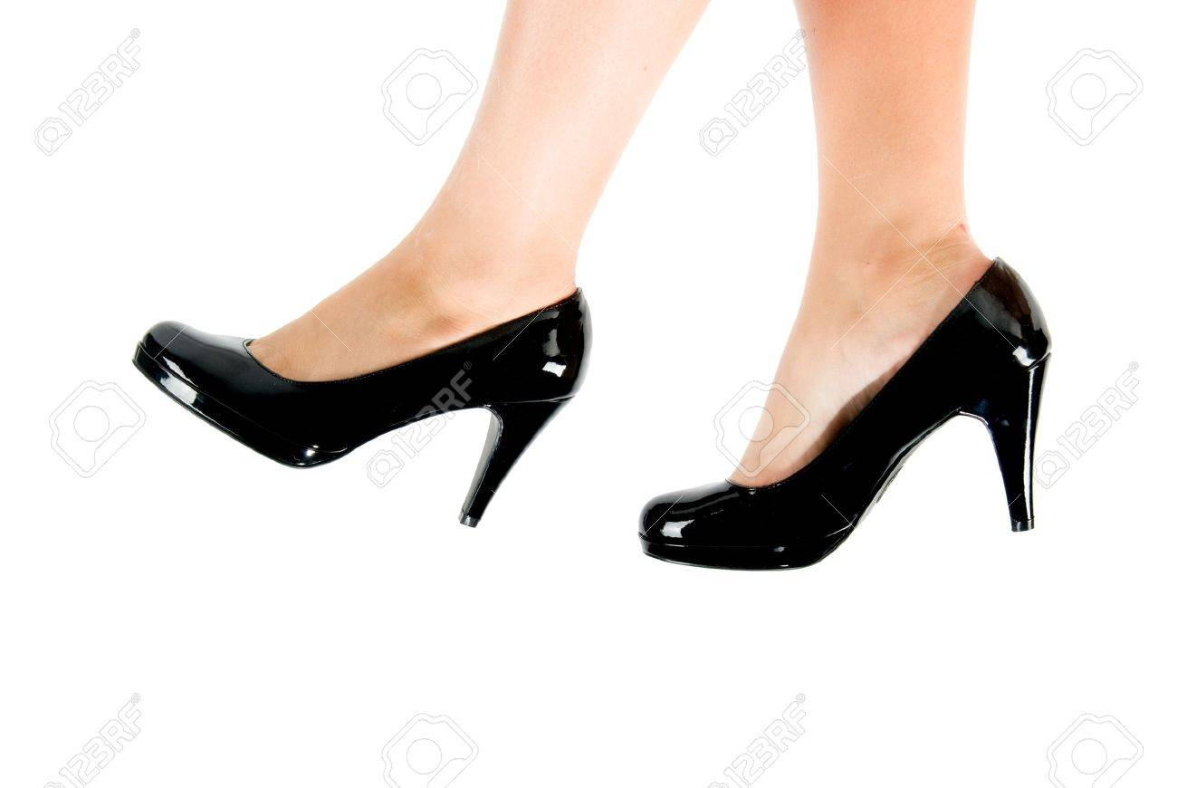 female feet wearing black shoes with high heals Stock Photo - 3970974