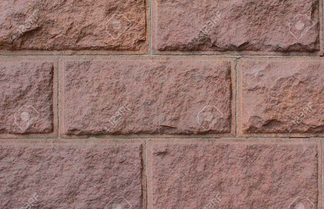 Building a decorative stone wall images home wall decoration ideas a decorative background a wall from a red artificial stone a decorative background a wall from amipublicfo Choice Image