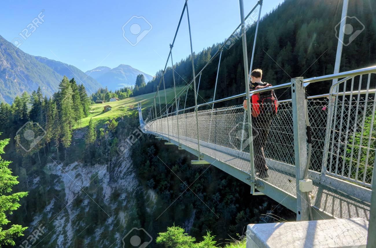 HOLZGAU, AUSTRIA 20 June 20 A Man With A Backpack Walks Over A ...