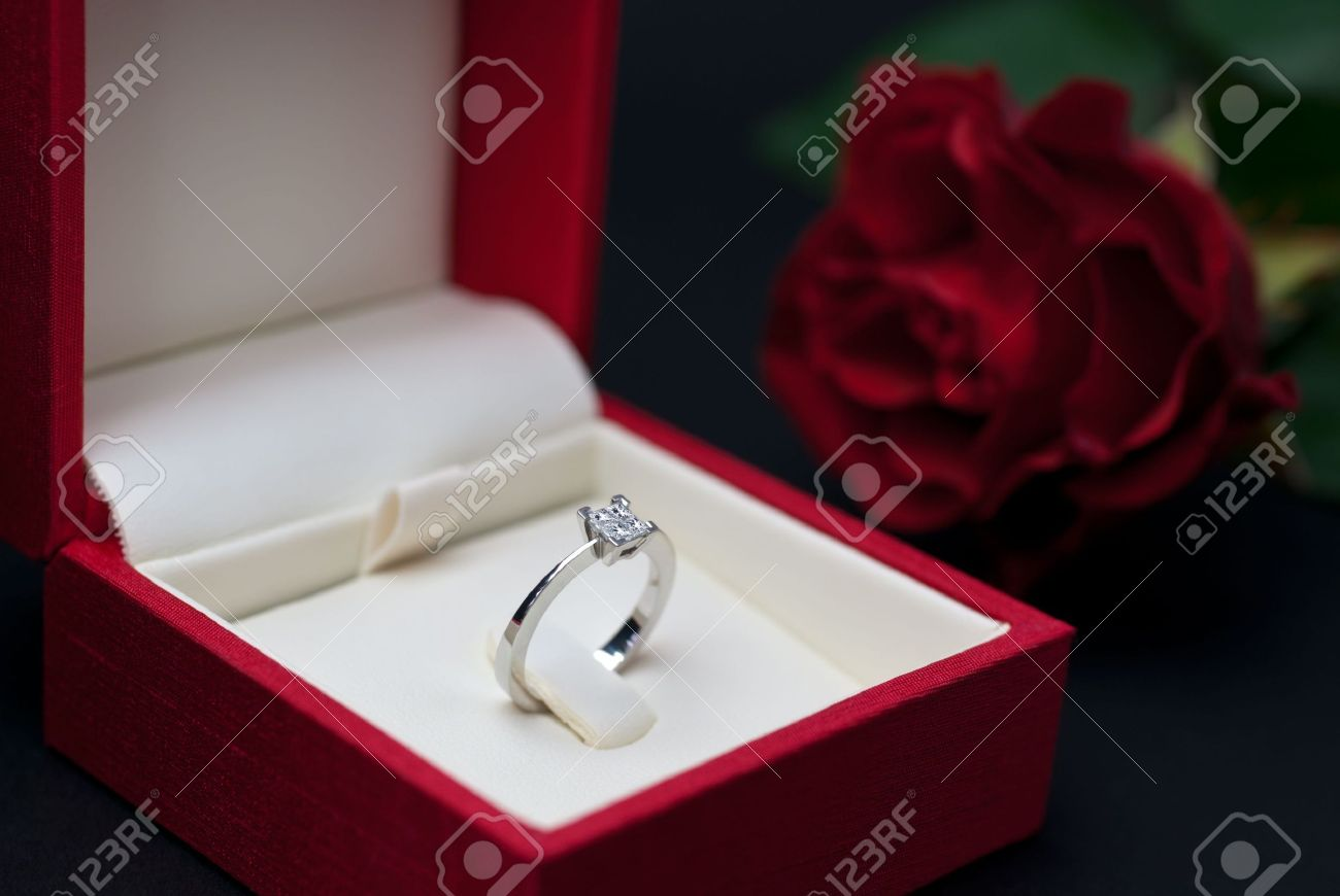 Modern Diamond Engagement Ring In Red Jewellery Box On Black Background  (soft Focus) Stock