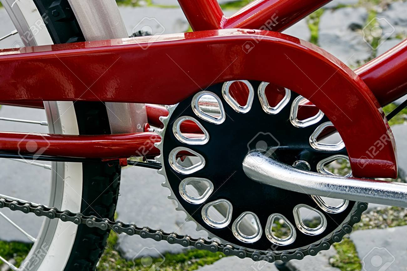 Detail of bicycle crank, chain, derailleur, red mudguards and rear wheel Stock Photo - 22664437