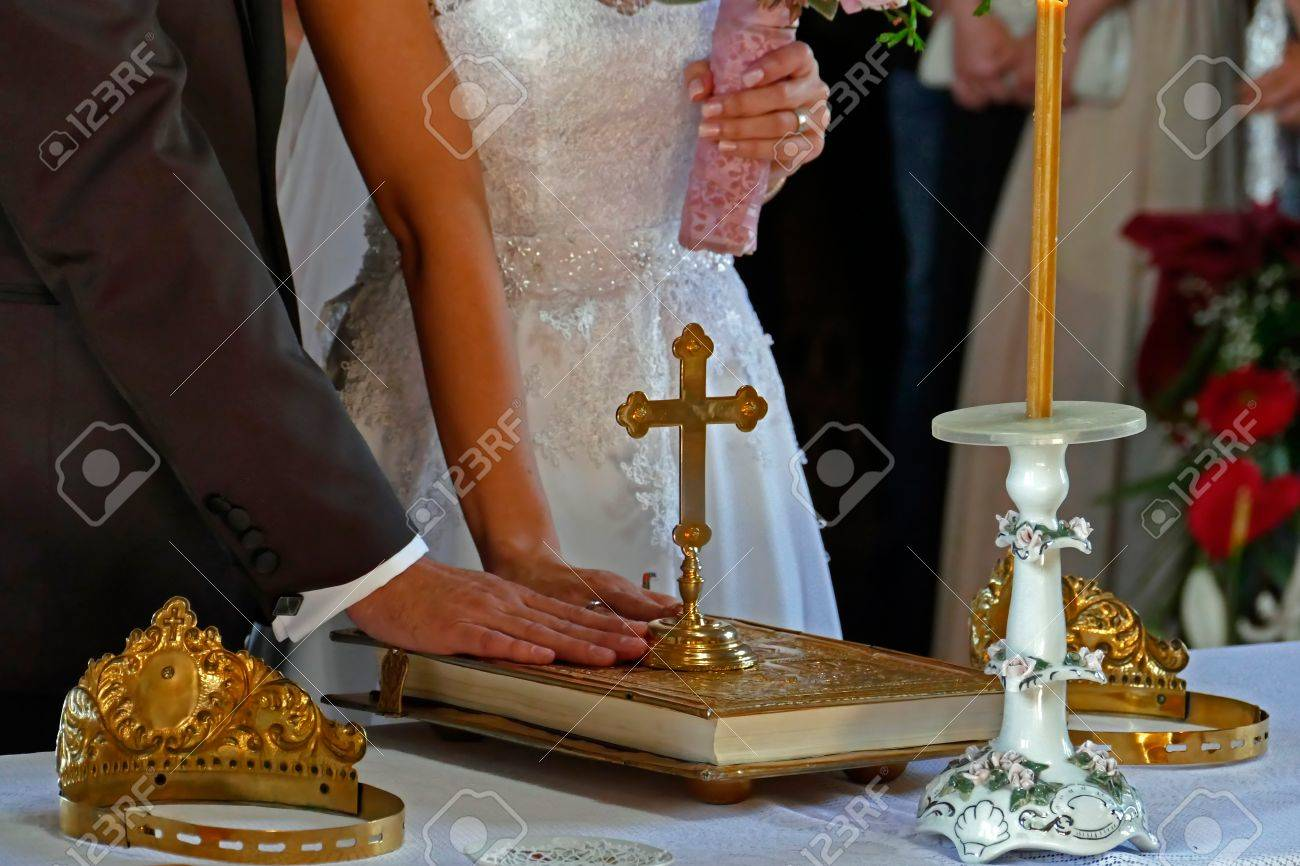 Groom and bride swear with hand on bible faith in marriage in a church. - 40975461