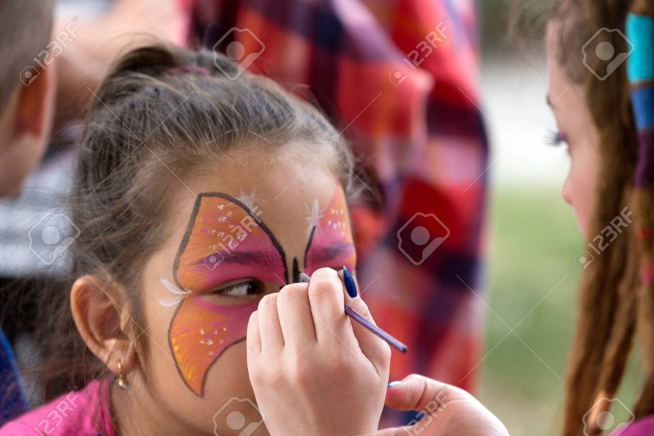 TIMISOARA, ROMANIA - JUNE 01, 2016: Workshop with face painting for children, in a park in Timisoara, Romania. International children Day. - 57849090