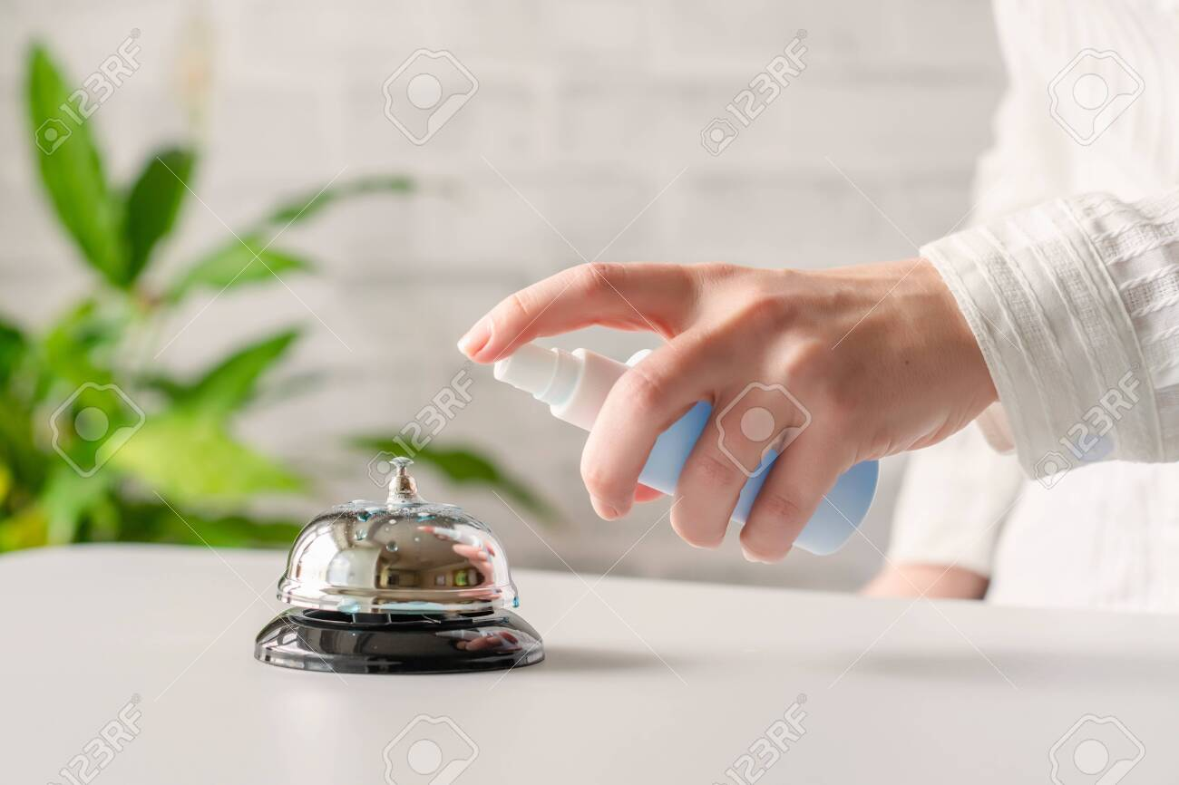Hand Of Woman Cleaning Ringing Bell On Reception Desk Disinfection Stock Photo Picture And Royalty Free Image Image 147845110