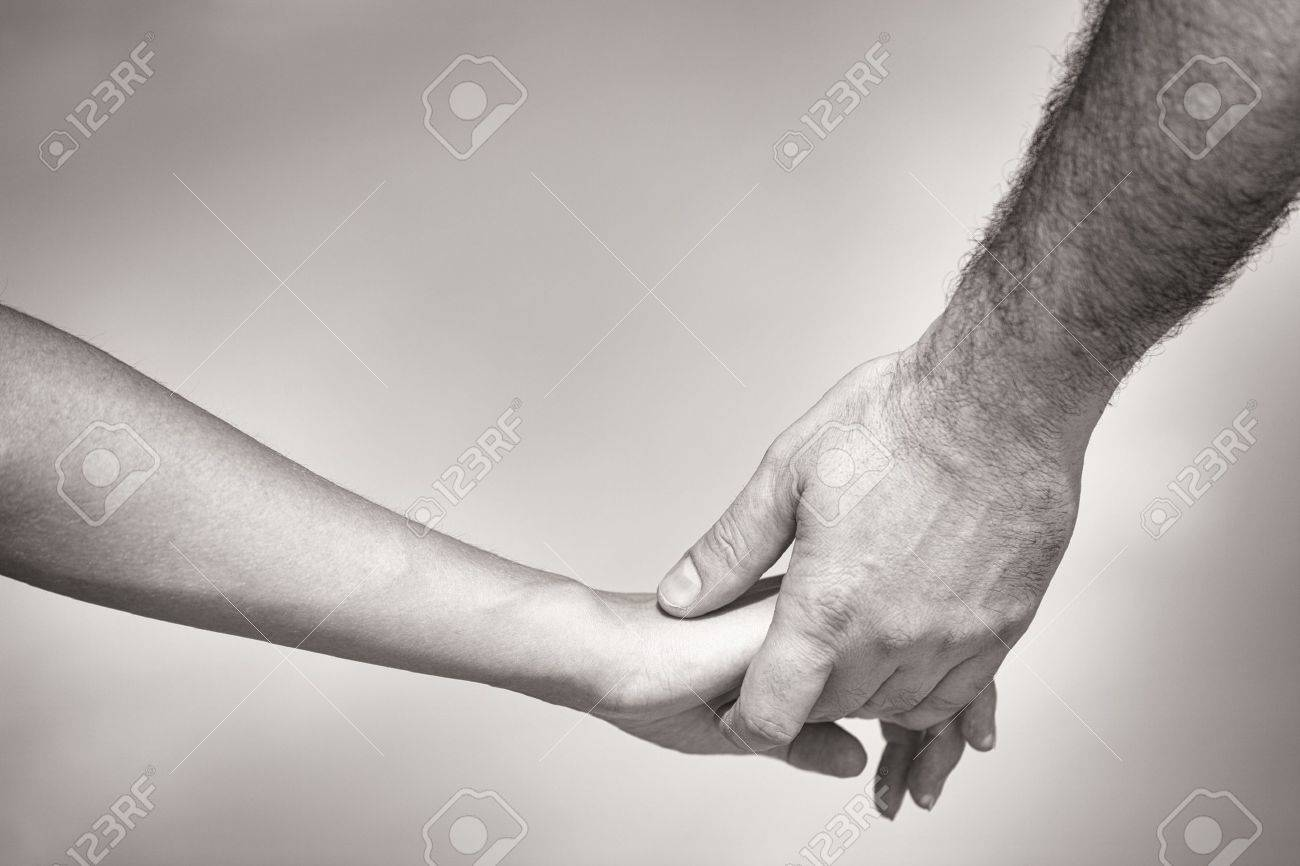 monotone shot of couple holding hands Stock Photo - 14930270