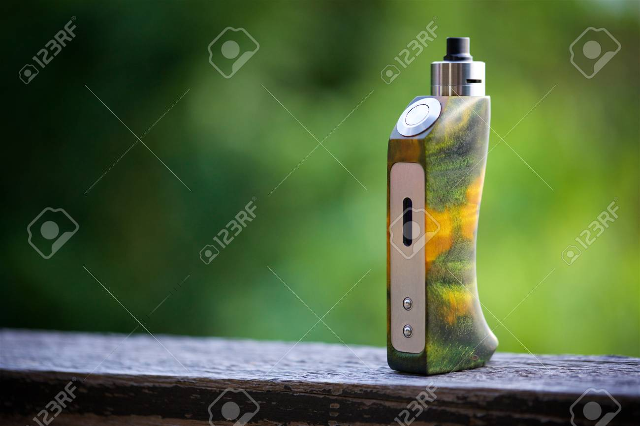 high end yellow green stabilized wood regulated box mods with