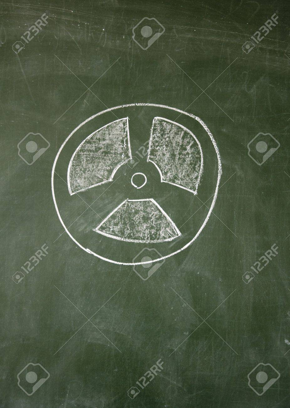 nuclear radiation sign drawn with chalk on blackboard Stock Photo - 12649394