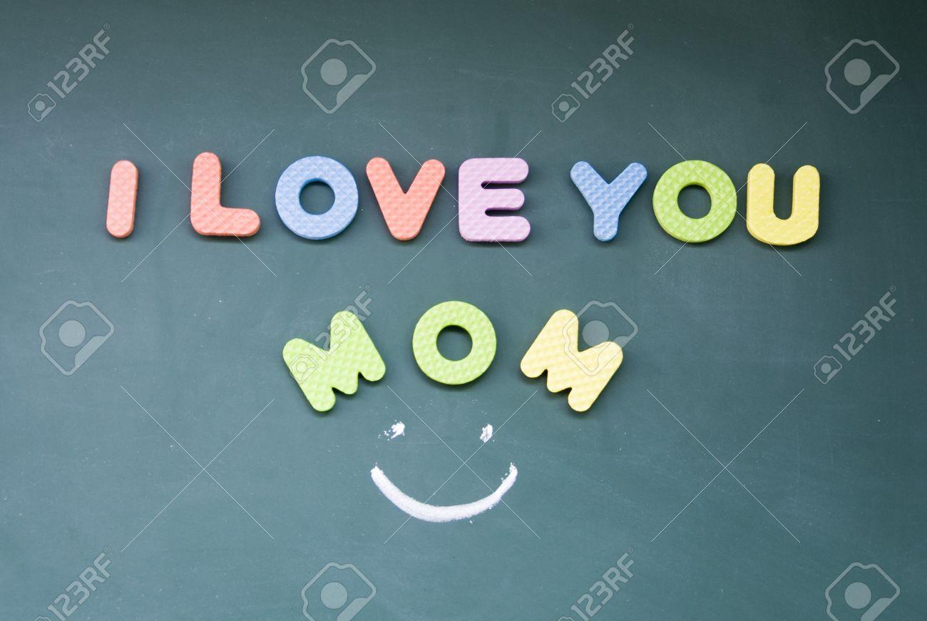 I Love You Mom Sign Drawn With Chalk On Blackboard