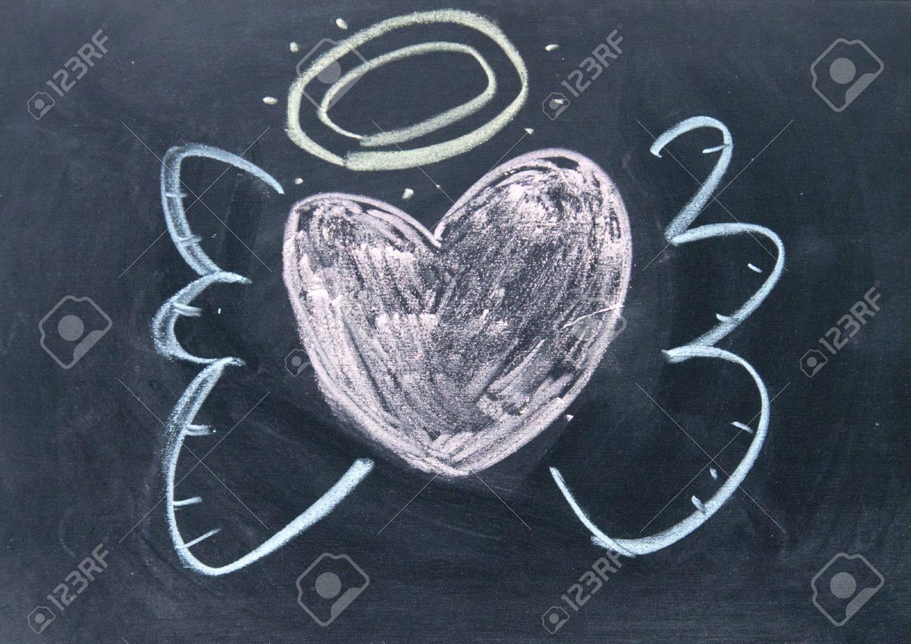 heart angel sign drawn with chalk on blackboard Stock Photo - 16654896