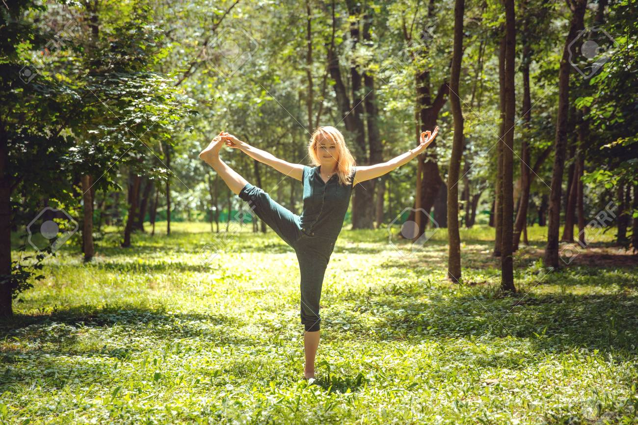 Utthita Hasta Padangustasana. Yoga asanas in nature. Yoga poses..