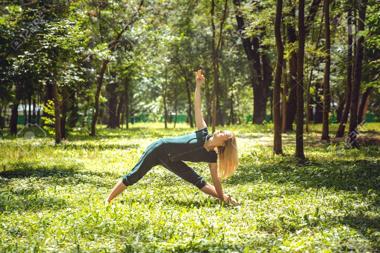 Utthita trikonasana. Yoga asanas in nature. Yoga poses everyday