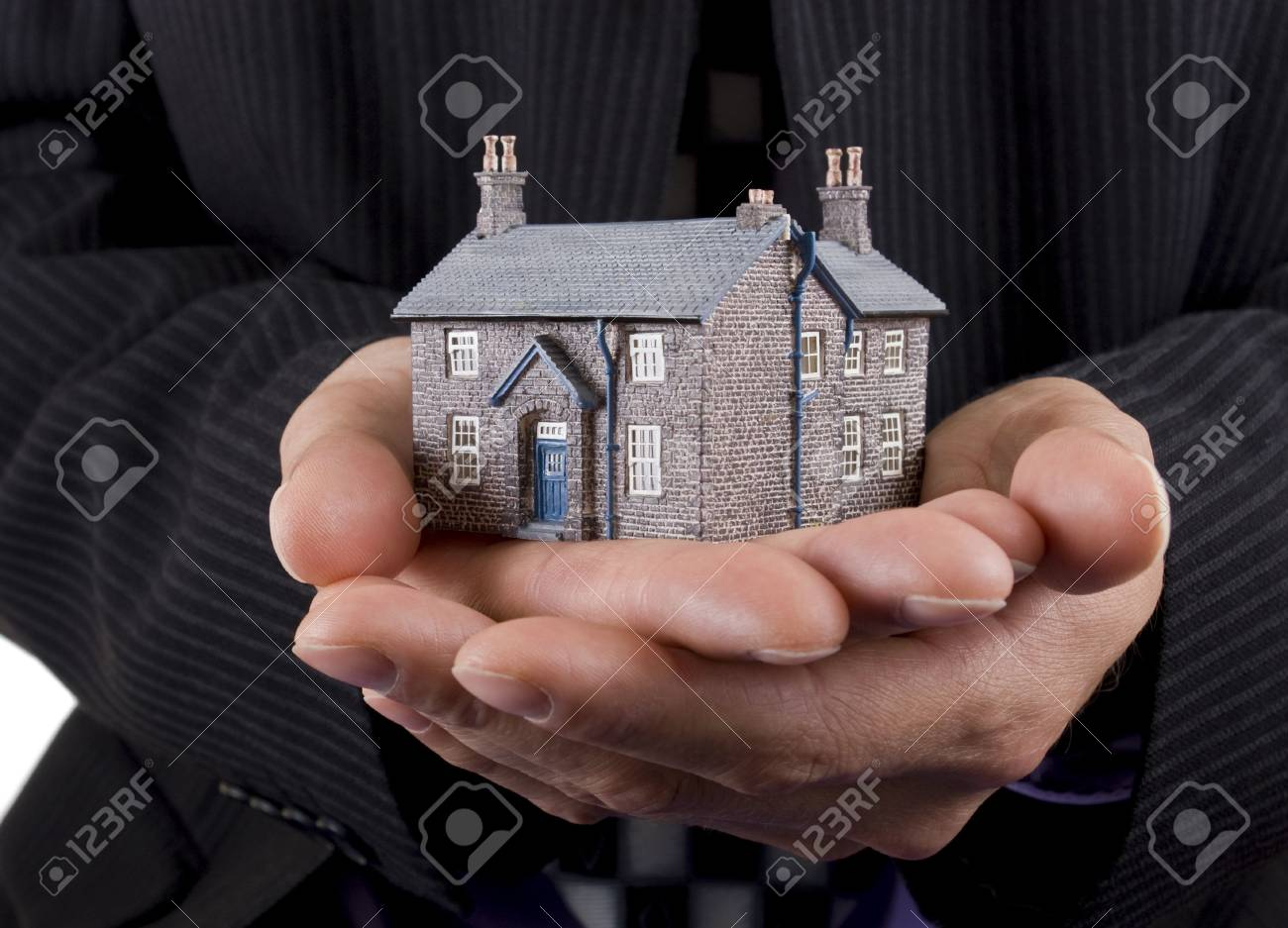 Real estate concept, businessman holding model house Stock Photo - 3458465