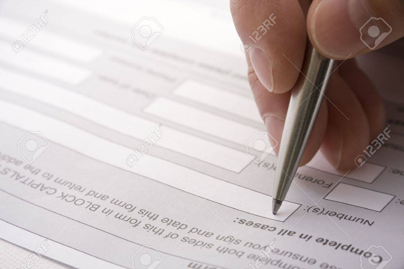 filling out details on a contract or application form stock photo filling out details on a contract or application form stock photo 3585876