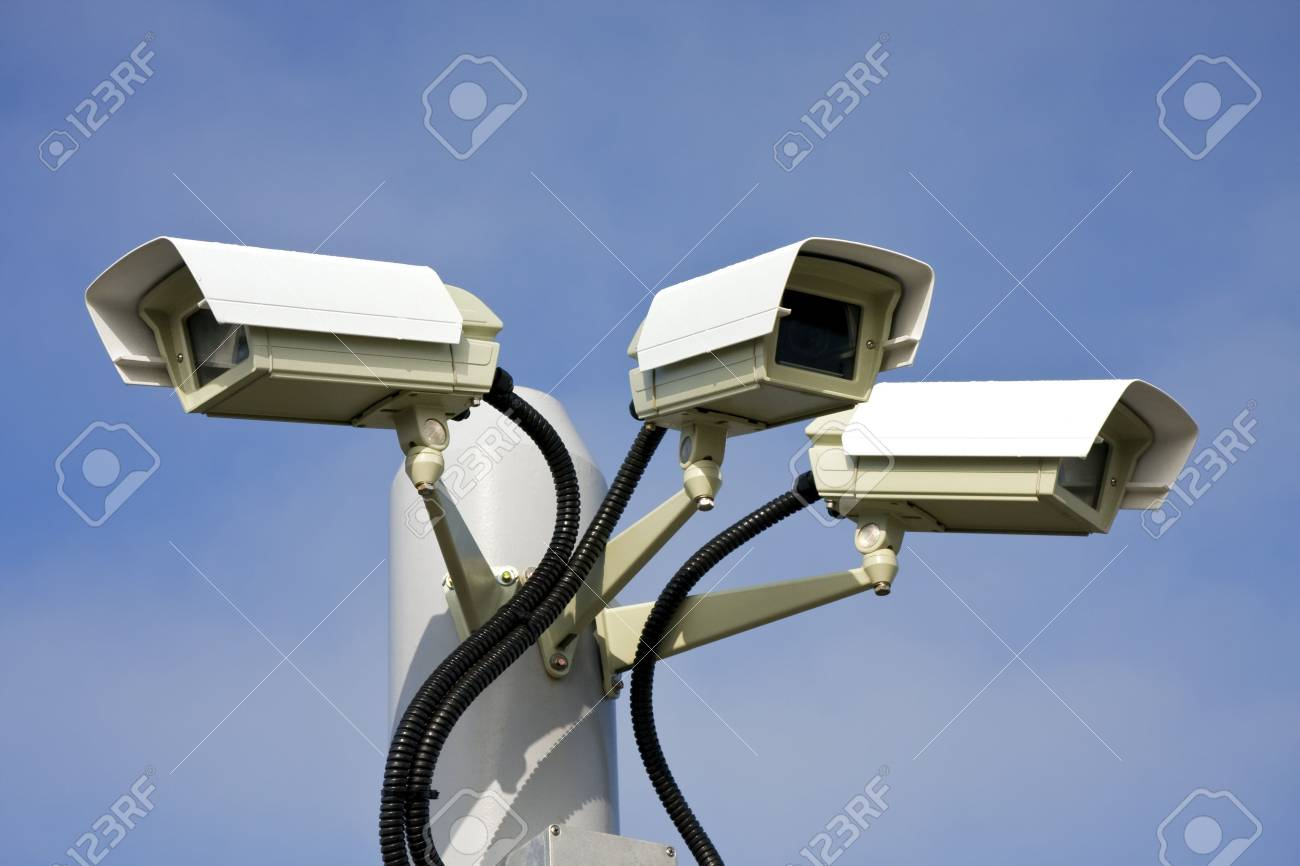 Security cctv cameras in front of blue sky Stock Photo - 3638980