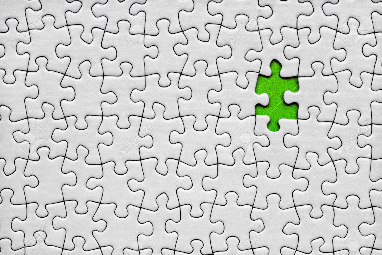 Jigsaw Puzzle With One Green Piece Missing Stock Photo, Picture And ...