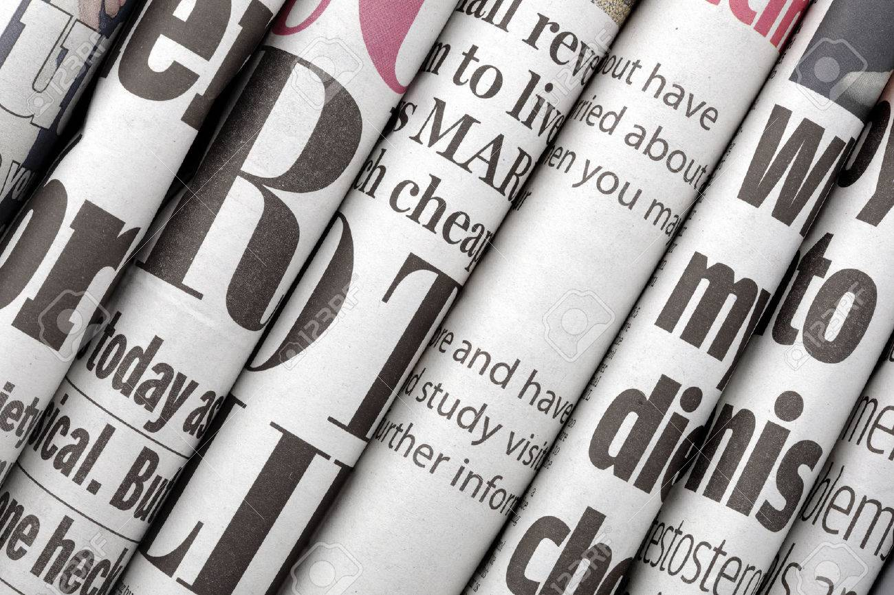 Newspaper headlines shown side on in a stack of daily newspapers - 25085092