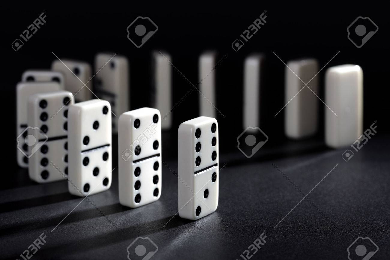 domino effect stock photos images royalty domino effect domino effect dominoes lined up ready to fall concept for domino effect balance and