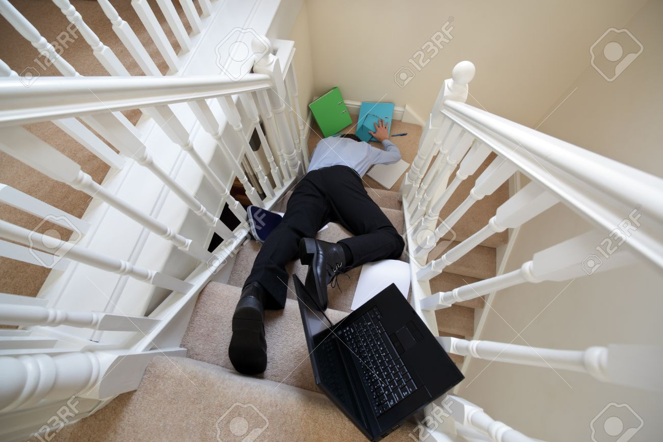 Business Man Falling Down The Stairs In Office Stock Photo