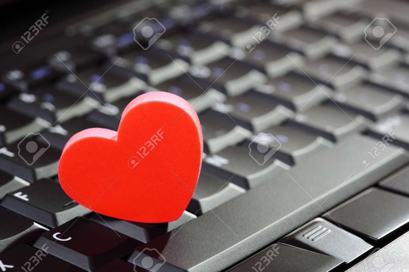 Love or online dating concept heart shape symbol on laptop keyboard love or online dating concept heart shape symbol on laptop keyboard stock photo 25487239 buycottarizona Choice Image