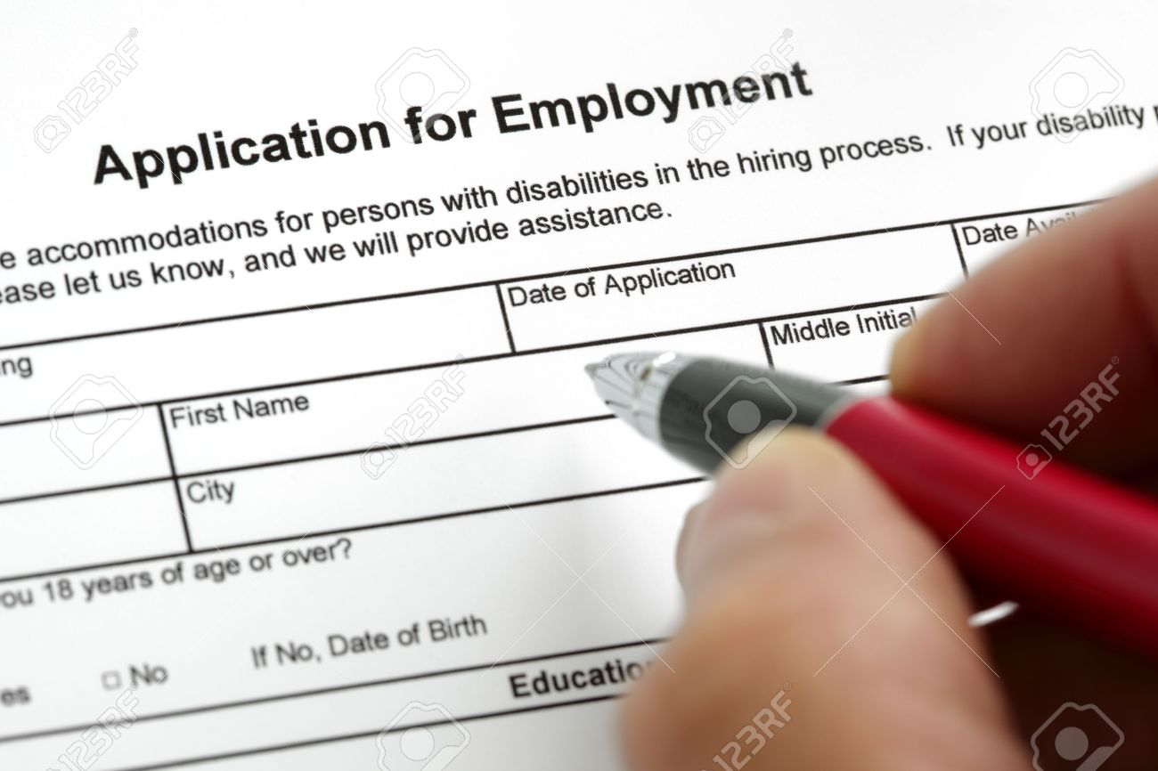 Completing An Job Application Form With Focus On Heading Stock ...