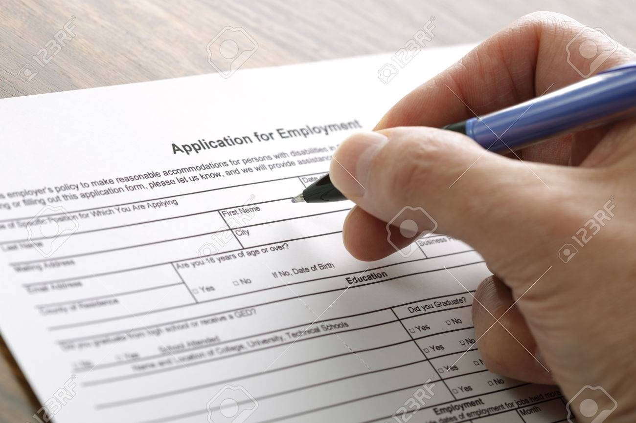 completing an employment application form stock photo picture and completing an employment application form stock photo 25907051