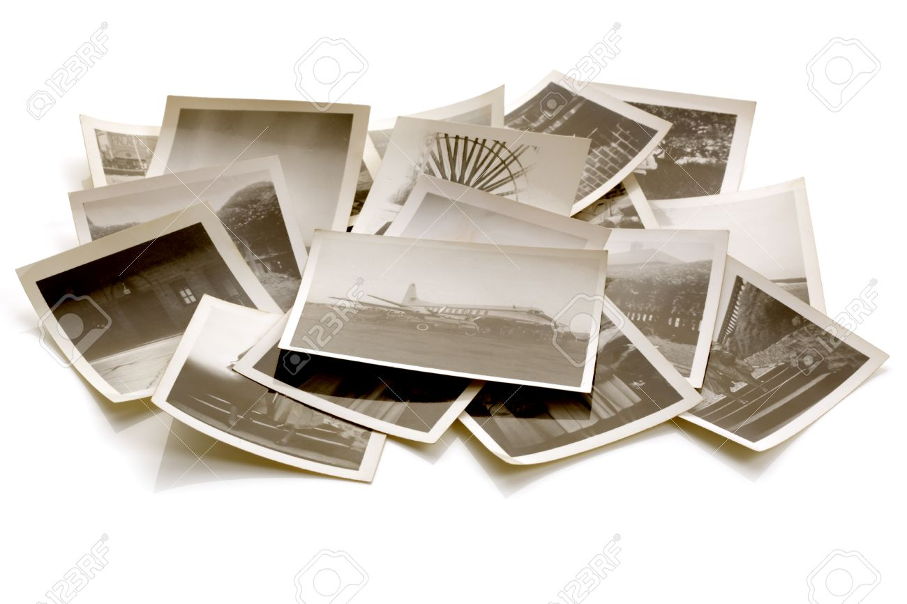Pile of old faded photographs from the family album with soft