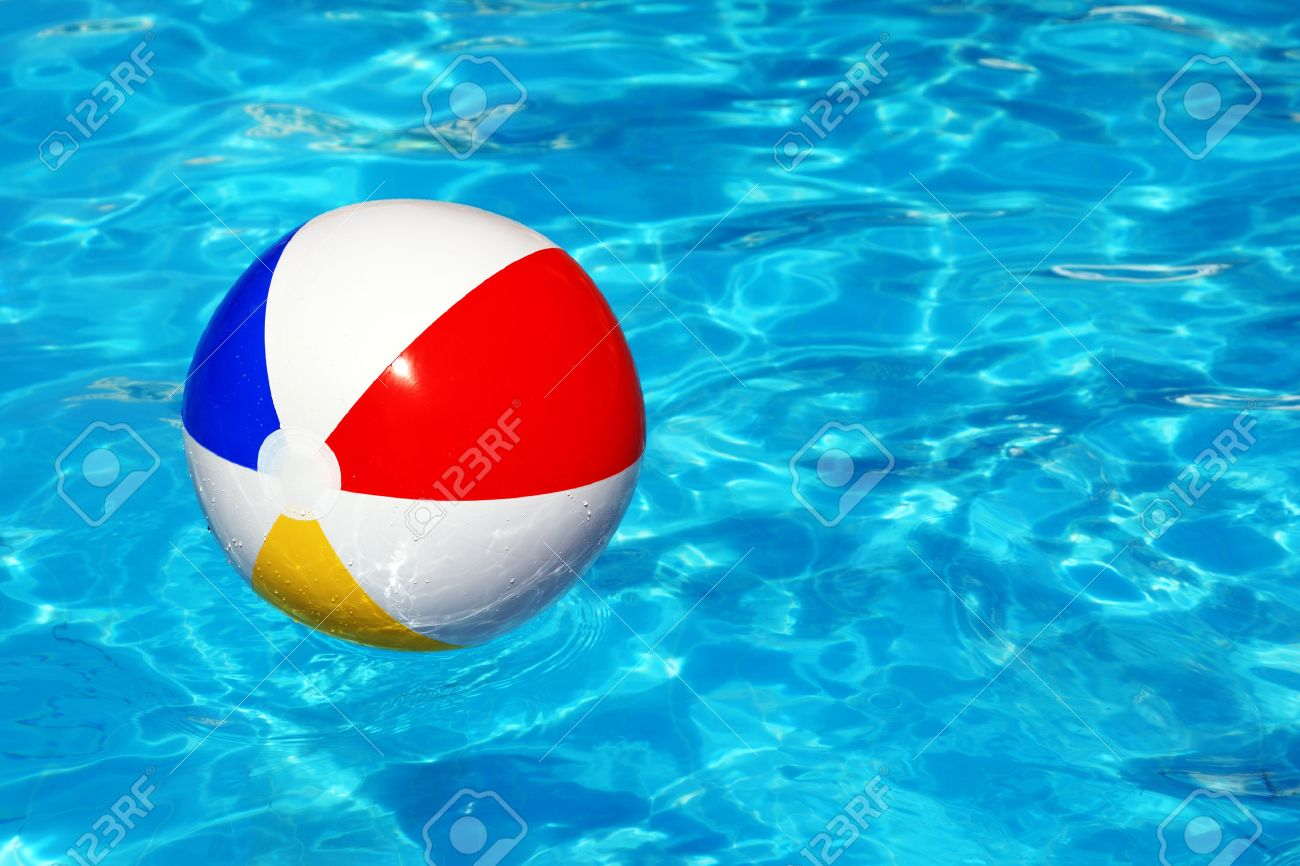 Pool Water With Beach Ball beach ball floating in swimming pool abstract concept for summer