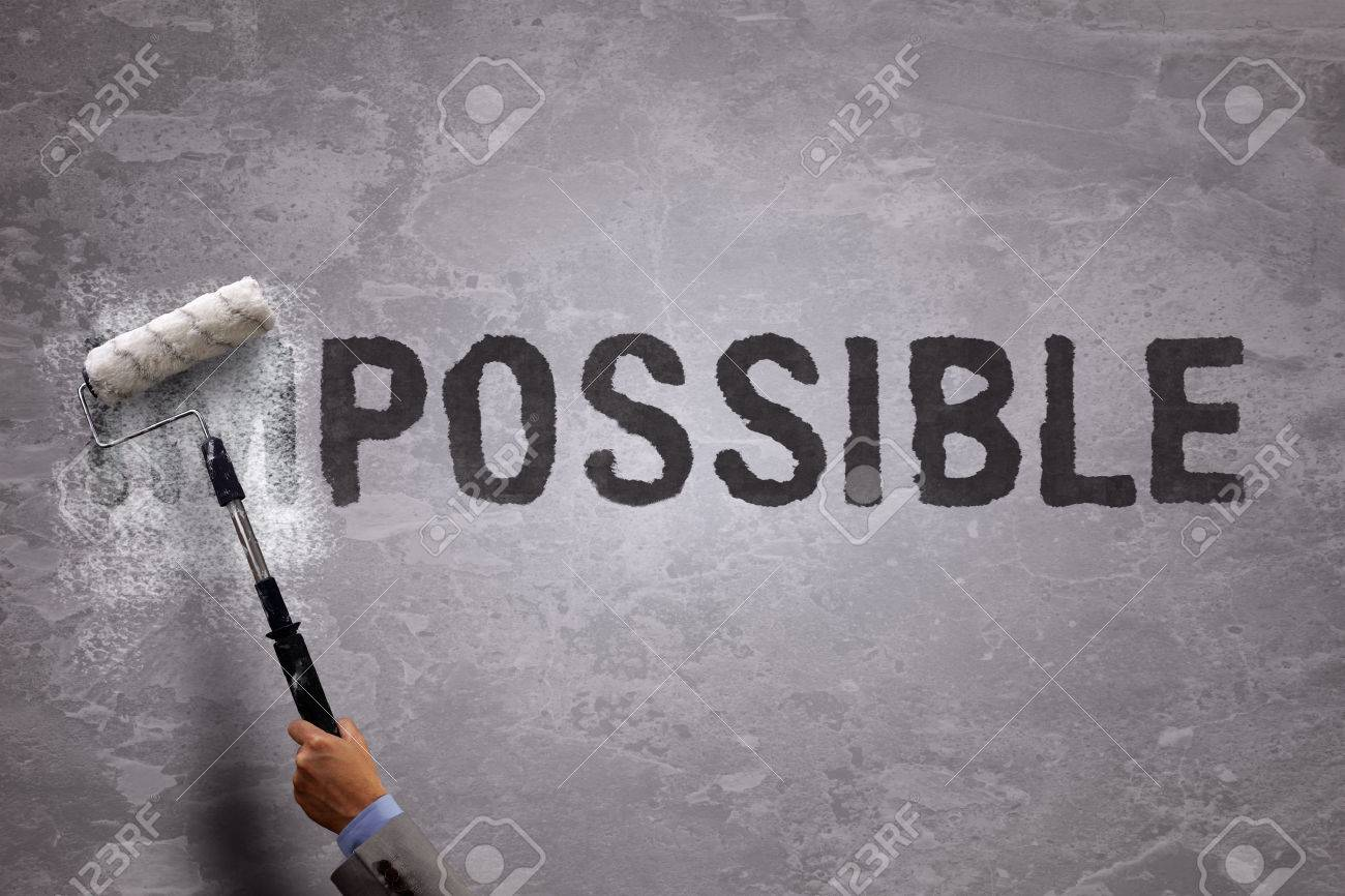 changing the word impossible to possible by painting over and