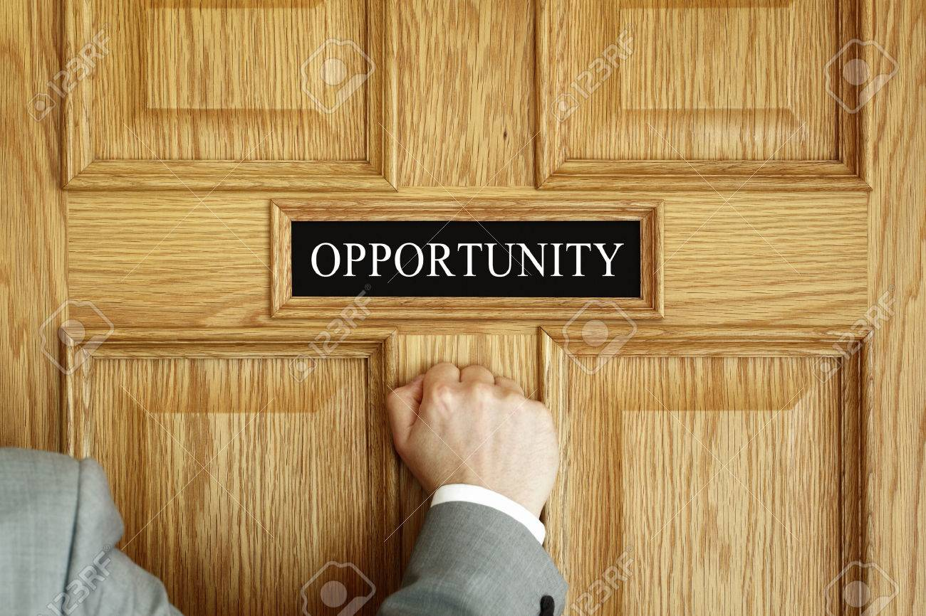 """Businessman knocking on a door to """"Opportunity"""" office concept for aspirations, progress meeting or promotion - 41771912"""