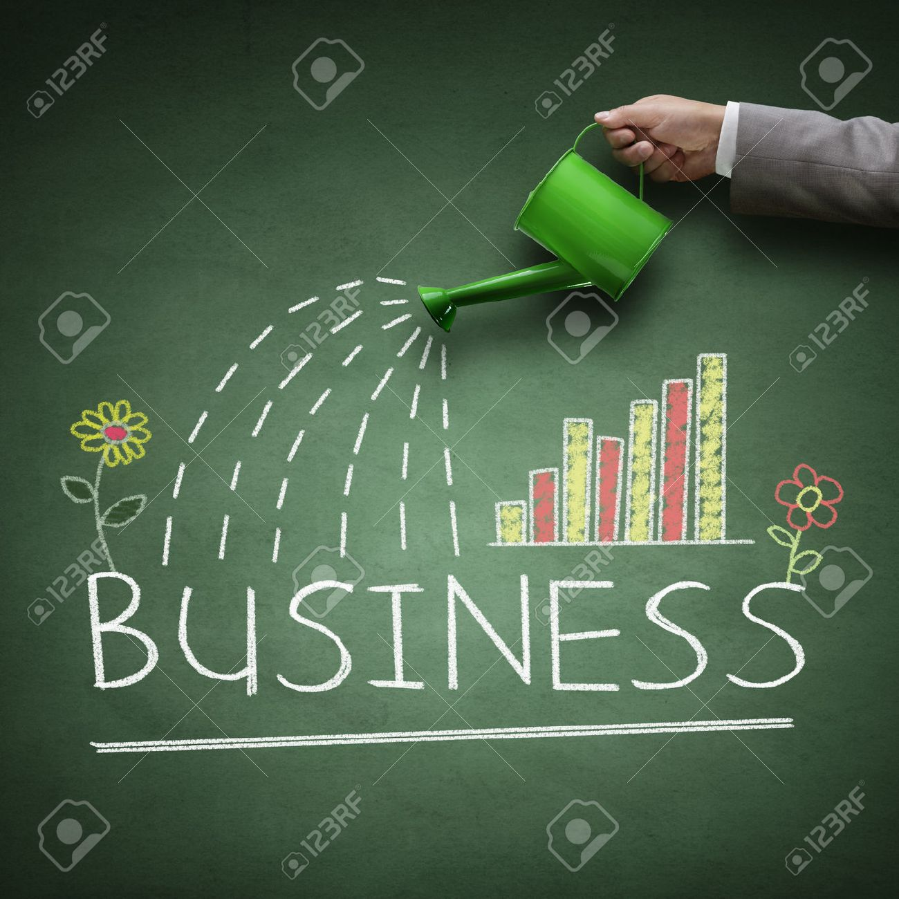 Watering can and word business drawn on a blackboard concept for business growth, investment, savings and making money Stock Photo - 45840469