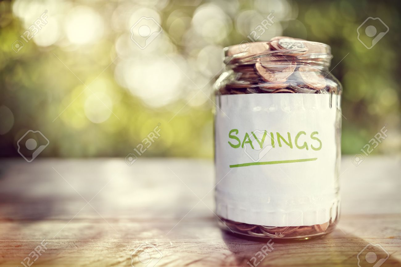 Savings money jar full of coins concept for saving or investment for a house, retirement or education Standard-Bild - 48355390