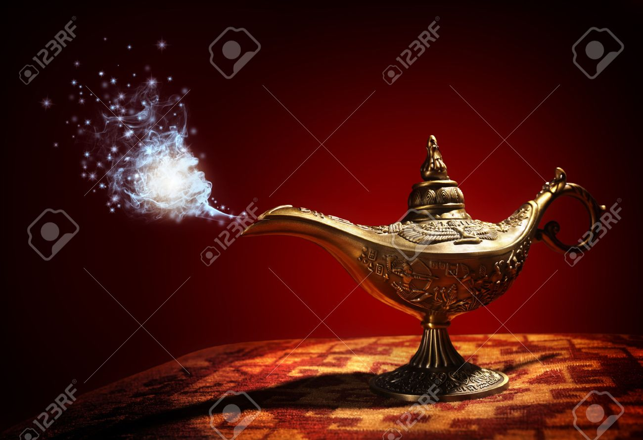 Magic lamp from the story of Aladdin with Genie appearing in blue smoke concept for wishing, luck and magic Standard-Bild - 48355407