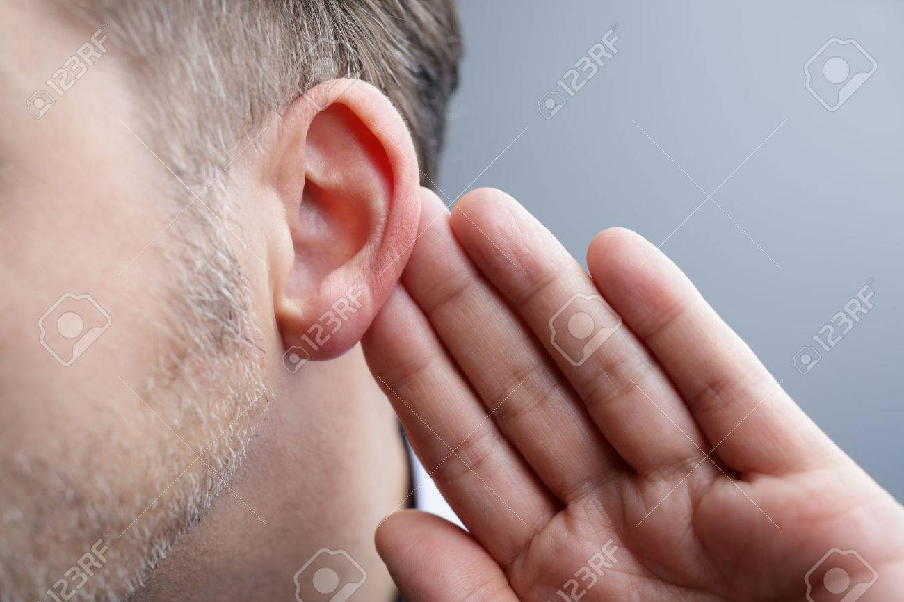 Man with hand on ear listening for quiet sound or paying attention Standard-Bild - 54427788