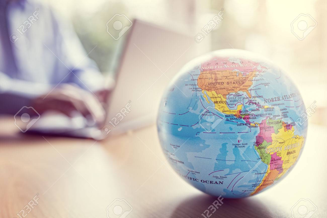 Businessman using a laptop with close up on world globe Standard-Bild - 54427801