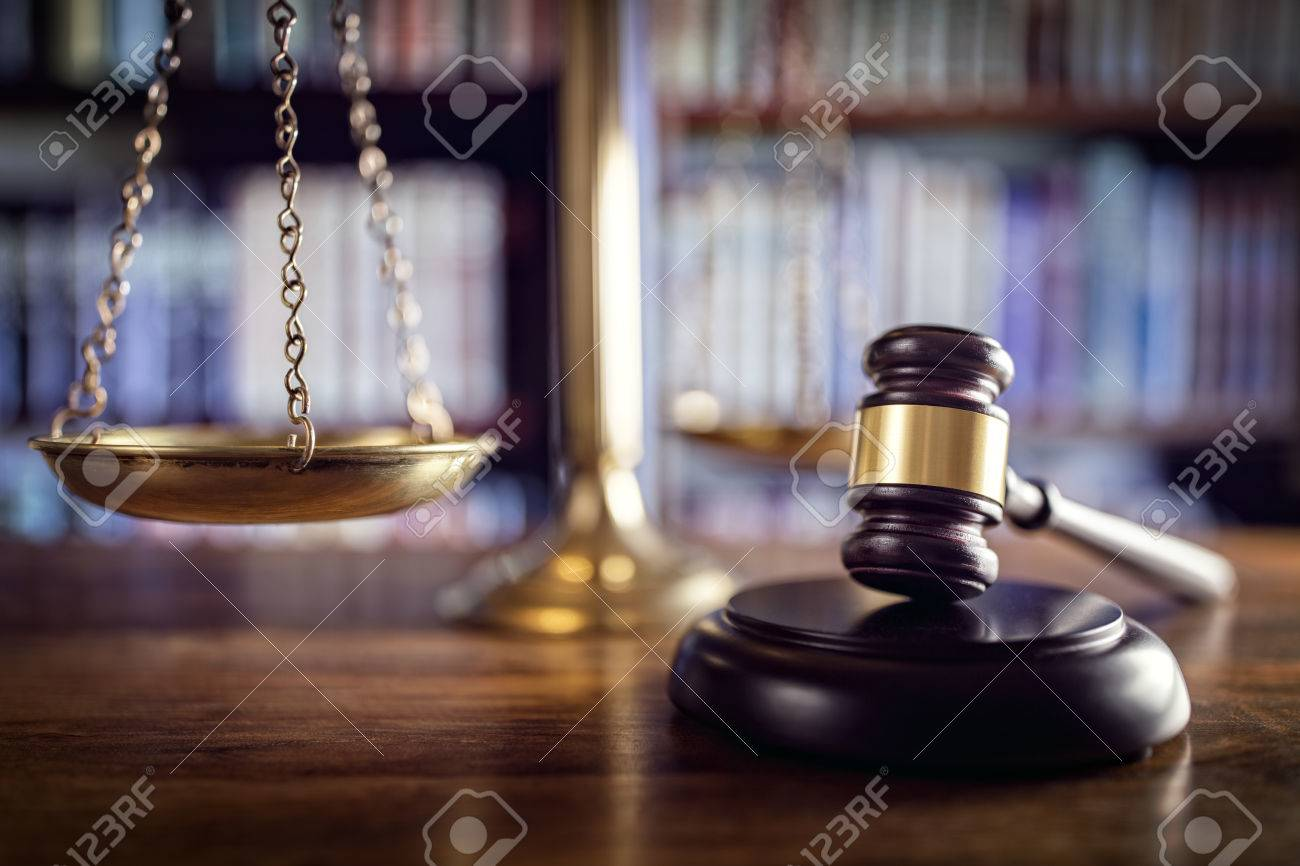 Judge gavel, scales of justice and law books in court - 54427908