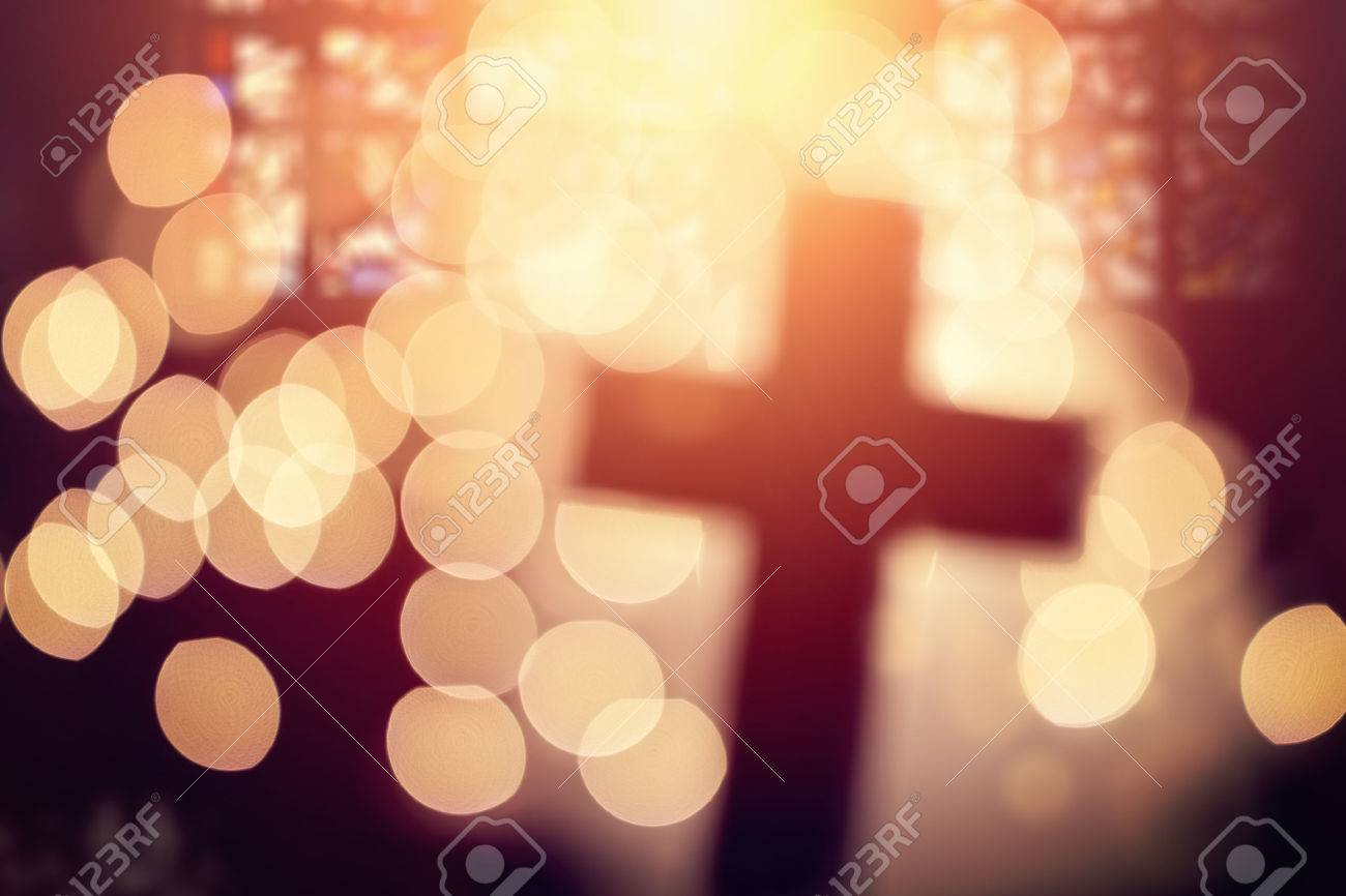 Abstract defocussed cross silhouette in church interior against stained glass window concept for religion and prayer - 54427916