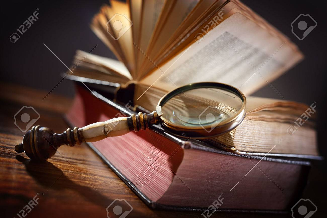 Book and magnifying glass concept for education, knowledge and searching for information - 54427923