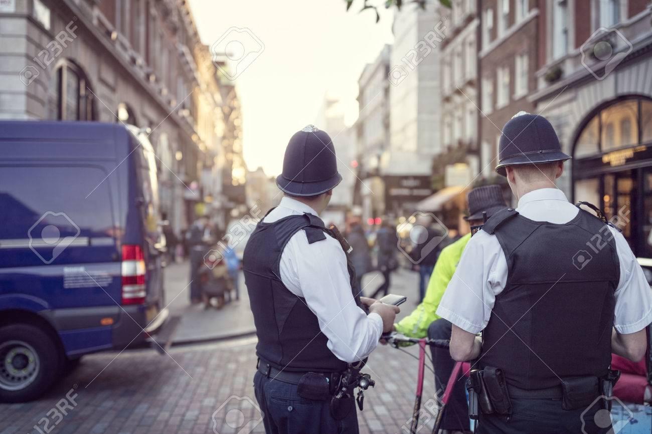 British police officers in helmets policing London streets Standard-Bild - 54428162