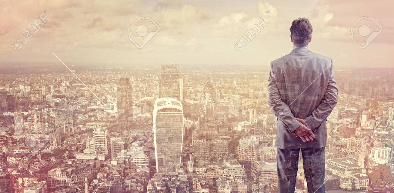 Businessman looking across the city of London financial district concept for entrepreneur, leadership and success Standard-Bild - 54428172