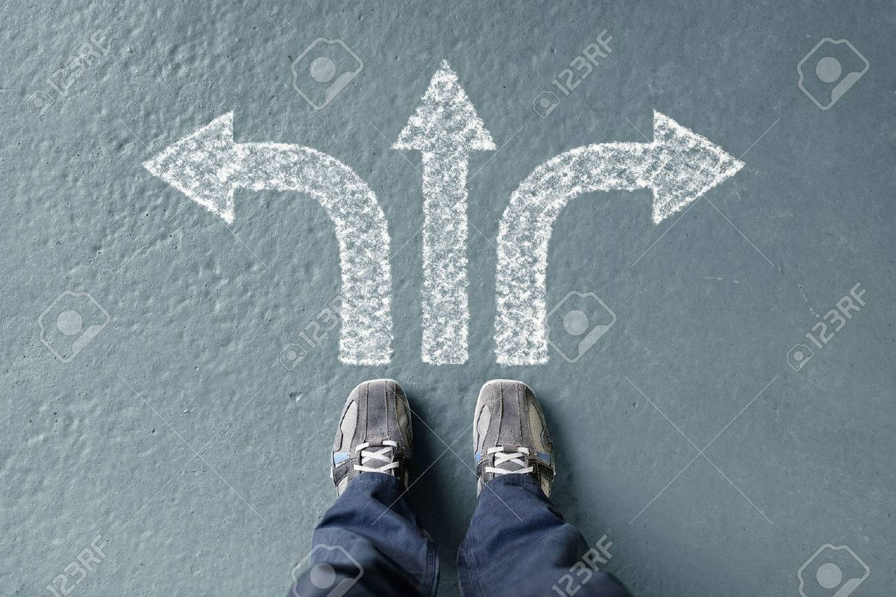 Taking decisions for the future man standing with three direction arrow choices, left, right or move forward Standard-Bild - 59291495