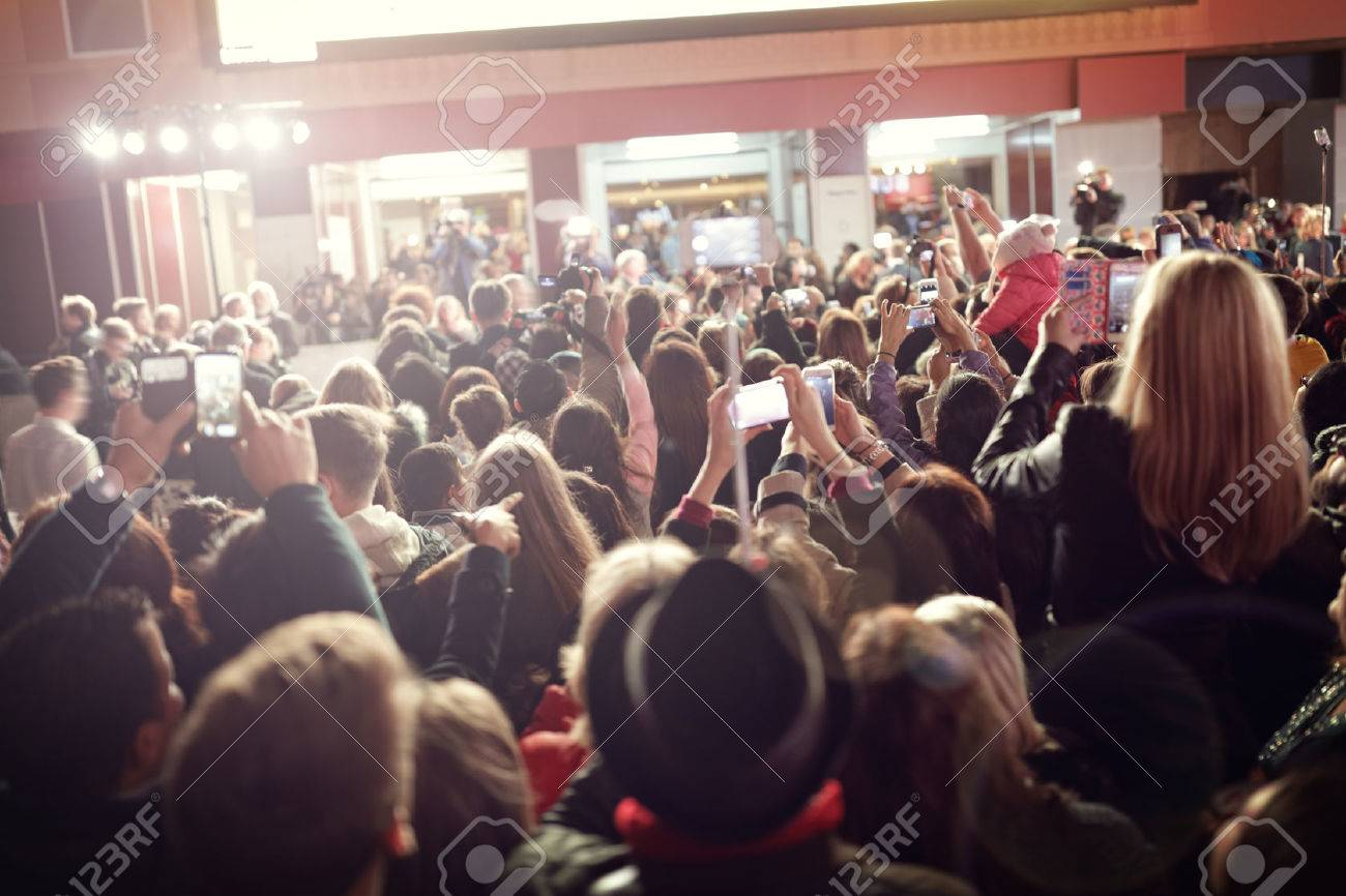 Crowd and fans taking photographs on mobile phones at a red carpet film premiere Standard-Bild - 61386067