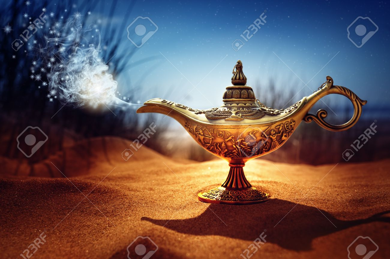 Magic lamp in the desert from the story of Aladdin with Genie appearing in blue smoke concept for wishing, luck and magic - 59291501