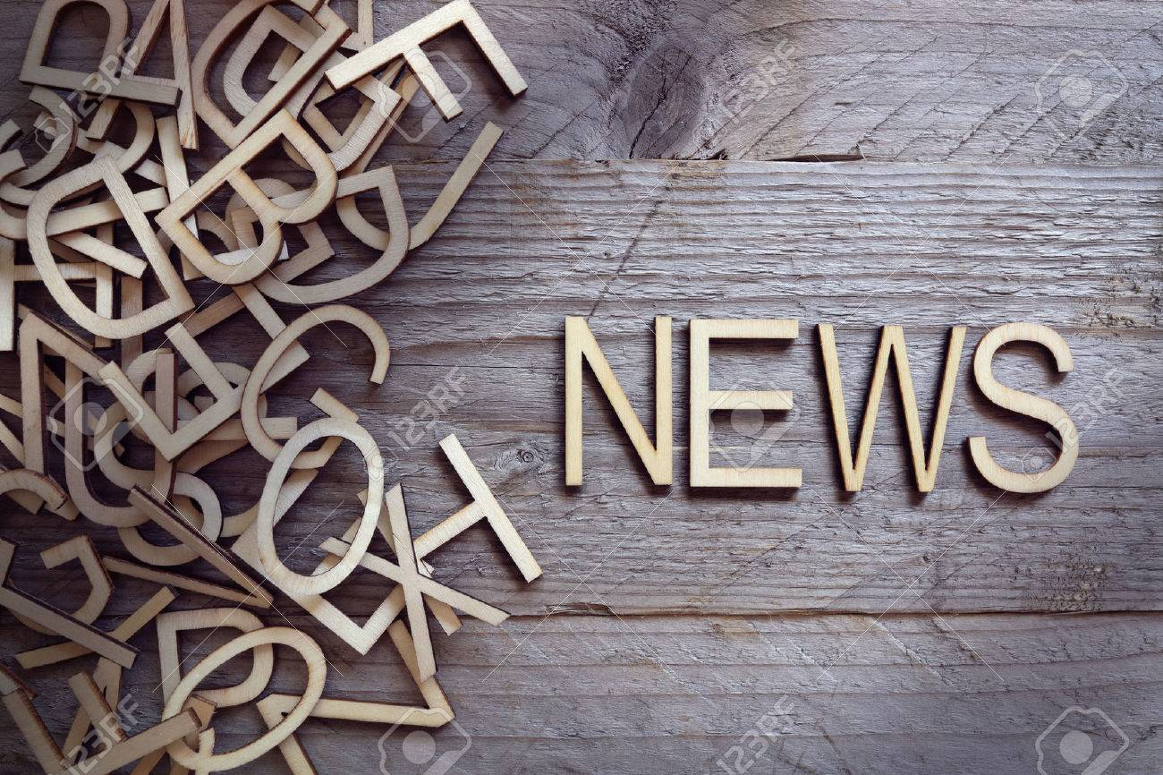 News and media concept wood letters on wooden background - 61385547