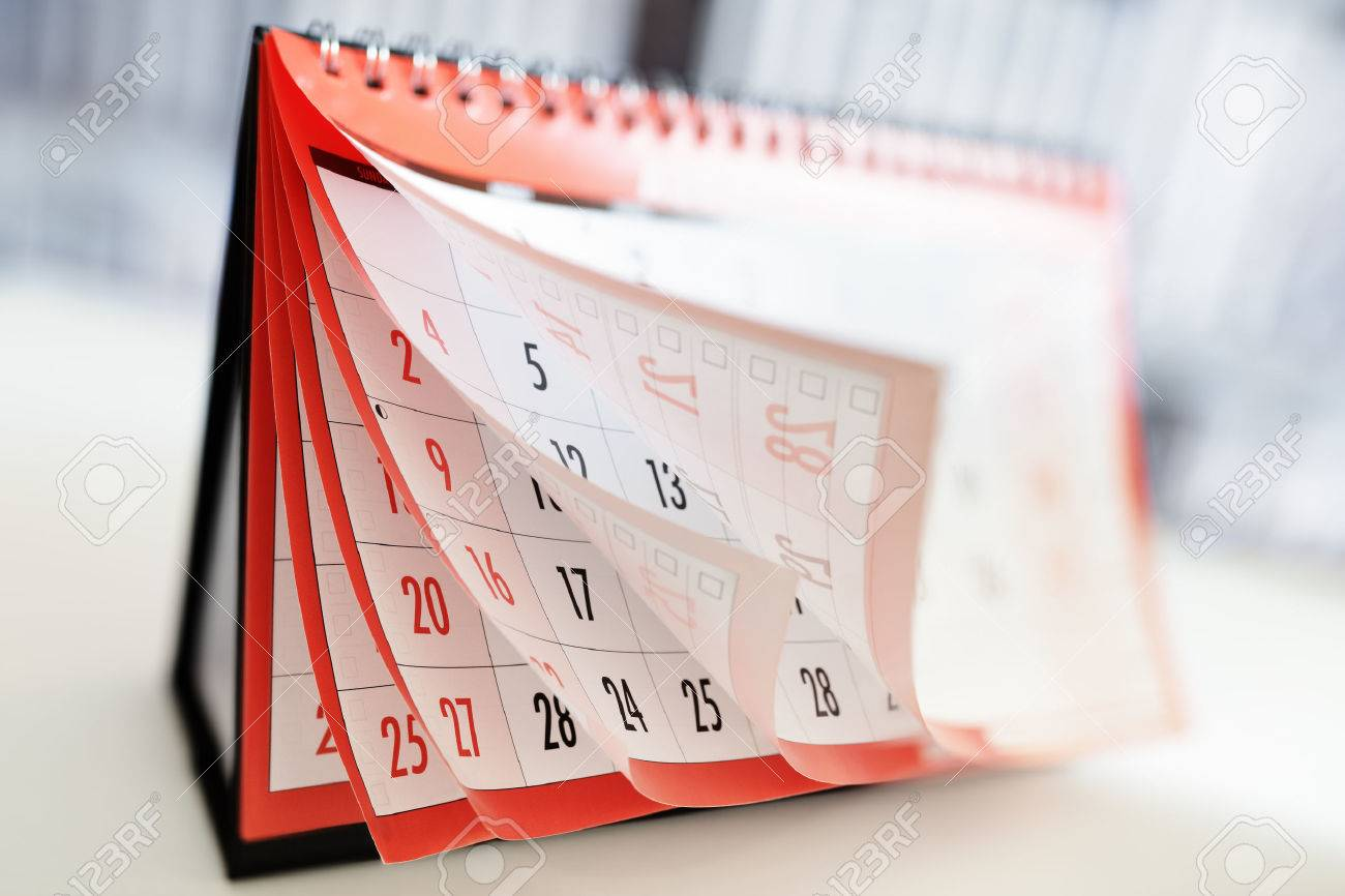 Months and dates shown on a calendar whilst turning the pages - 69131464