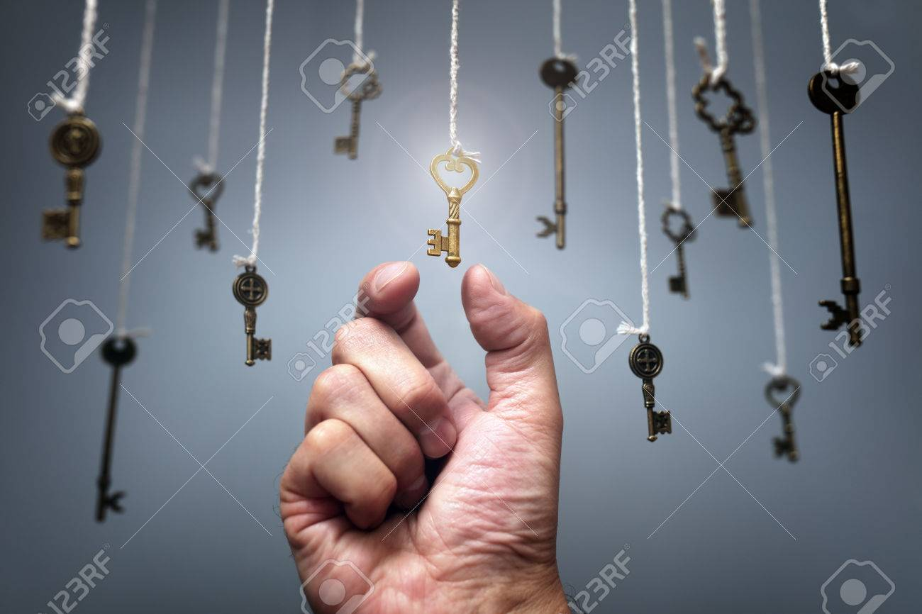 Choosing the key to success from hanging keys concept for aspirations, achievement and incentive - 67025481