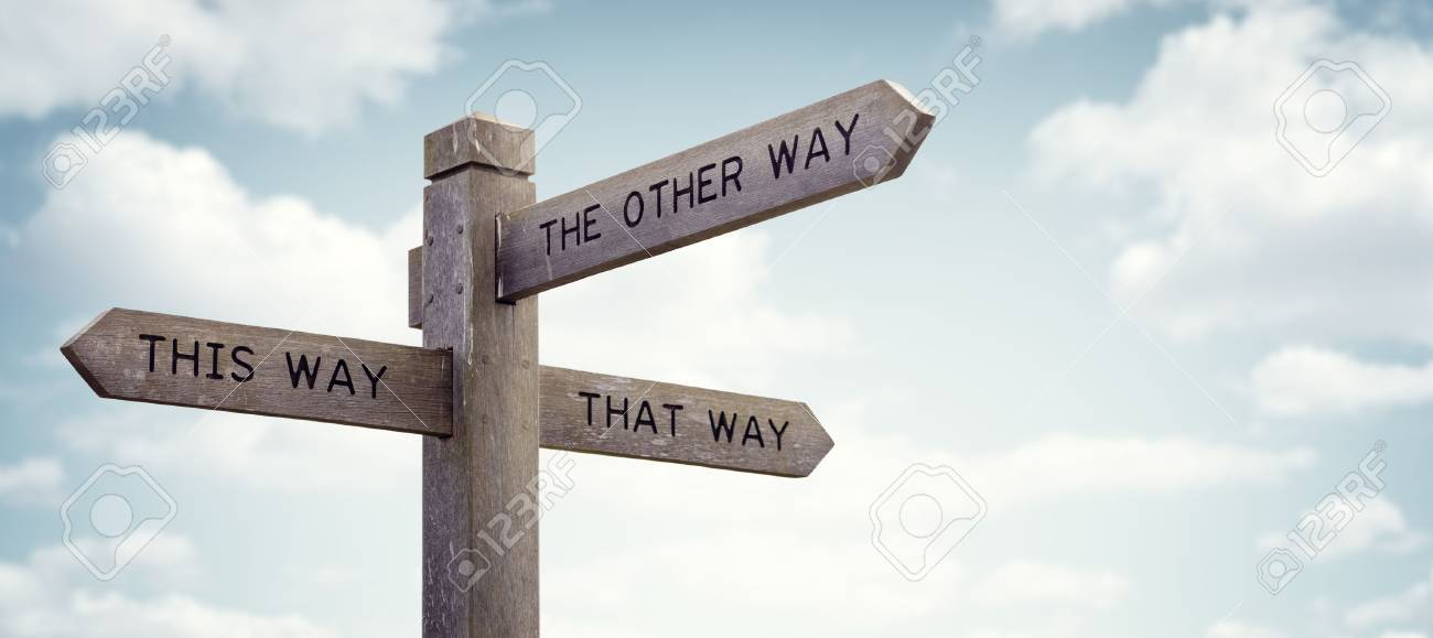 crossroad signpost saying this way that way the other way concept