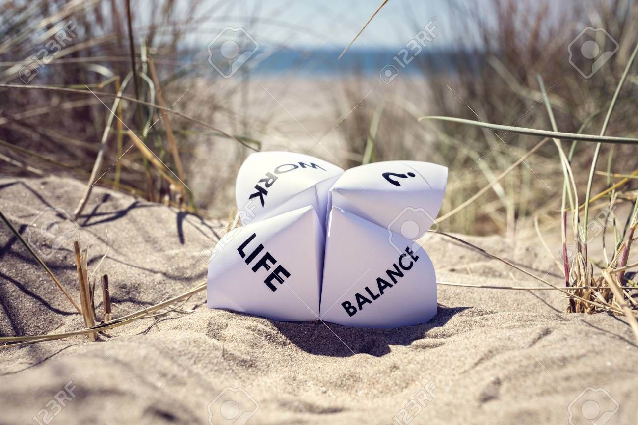 Origami fortune teller on vacation at the beach concept for work life balance choices - 80025272