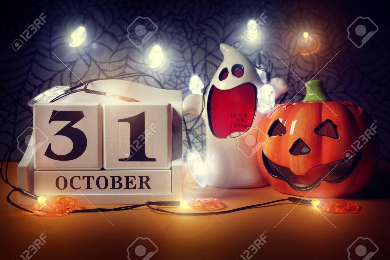 halloween calendar date 31st october with pumpkin and ghost stock