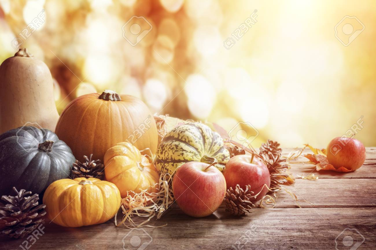 Thanksgiving, fall or autumn greeting background with pumpkin on table - 114514573