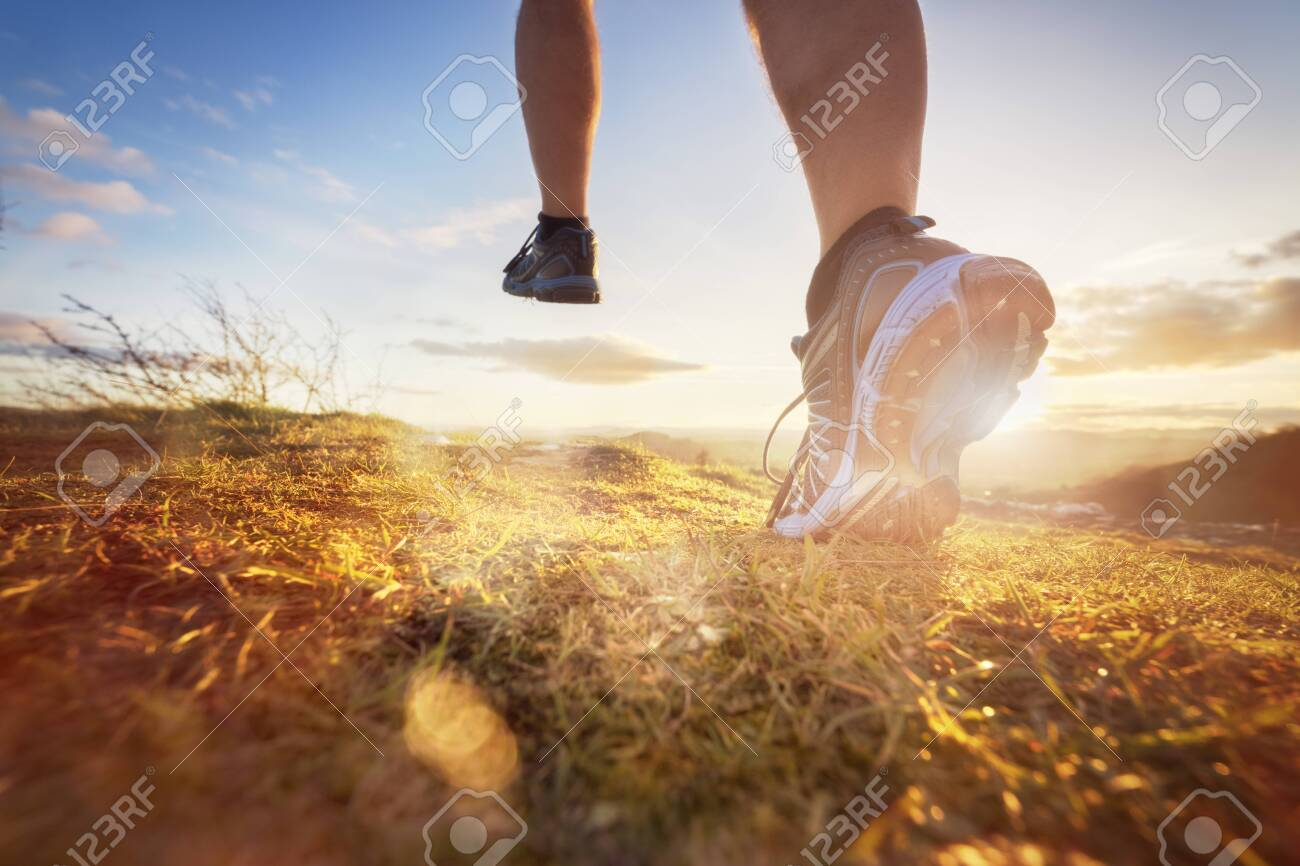 Outdoor cross-country running in morning sunrise concept for exercising, fitness and healthy lifestyle - 131760038